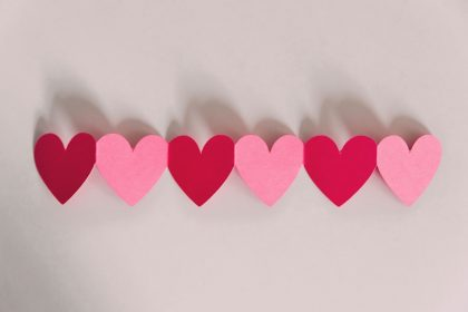 paper hearts cut together