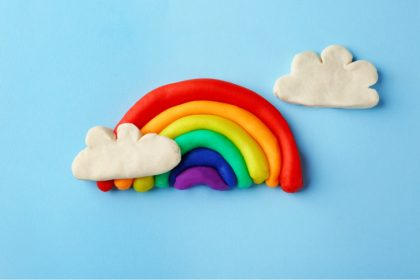a bright rainbow and clouds made of play doh